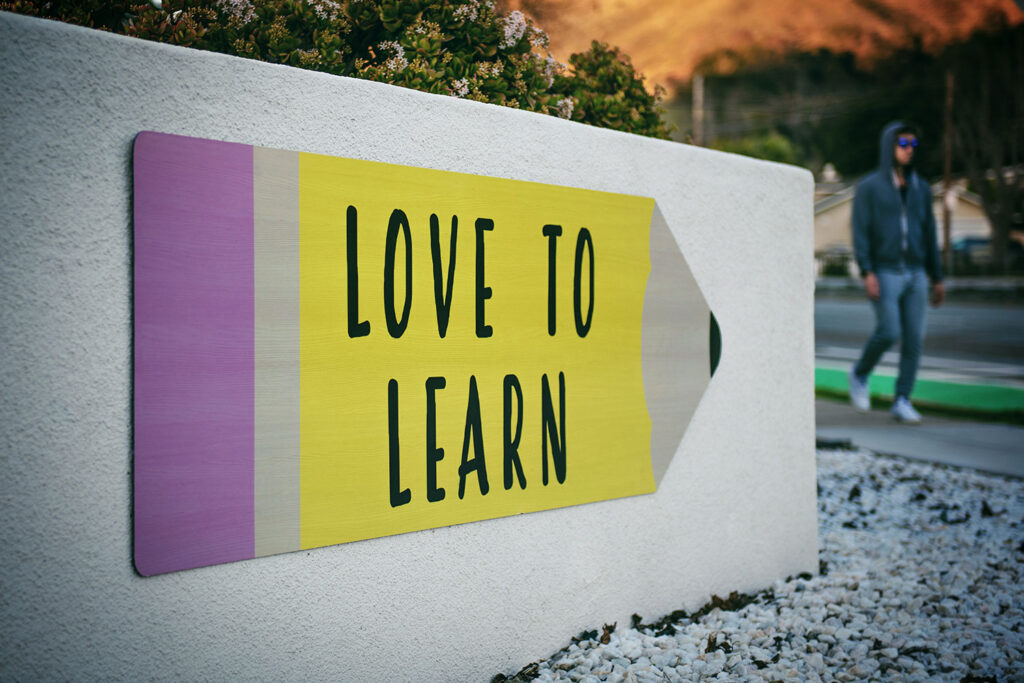 "An image of a sign that reads ""Love to Learn"""